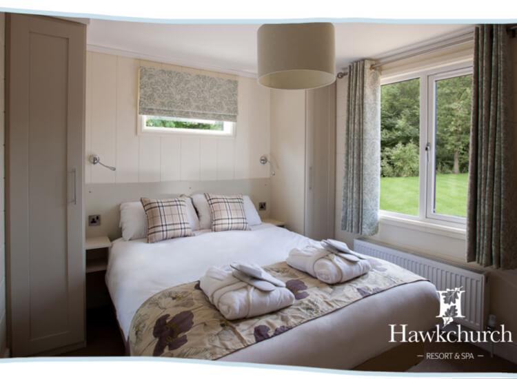 Interior shot of a bedroom in the Austen Premier lodge
