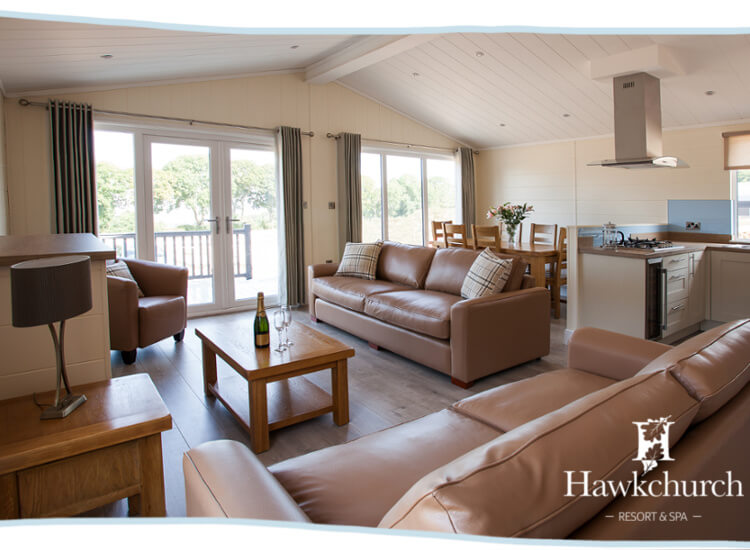 Interior shot of the open plan living area in the Austen Premier lodge