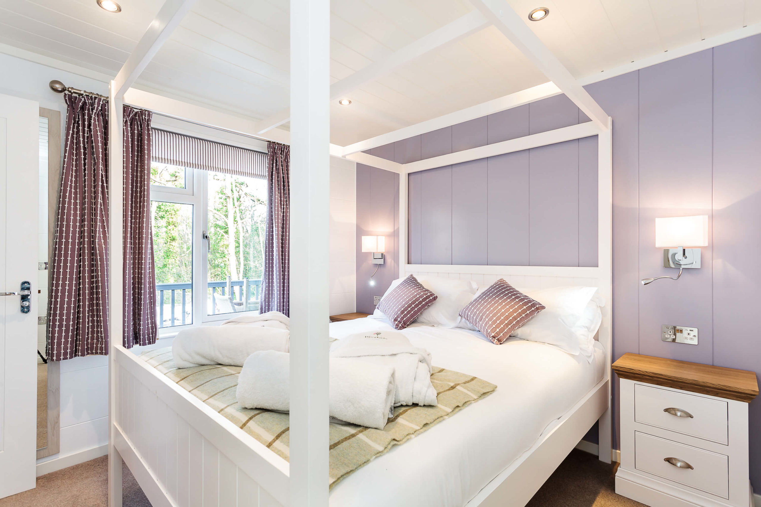 Interior shot of a bedroom in a lodge a Woodside Bay