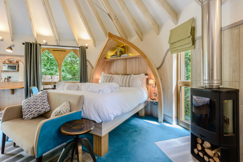 Interior shot of the bed in the treehouse at Woodside Bay