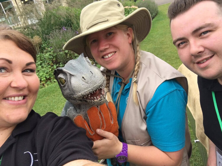 Darwin Escapes team pose with a zoo ranger and a dinosaur