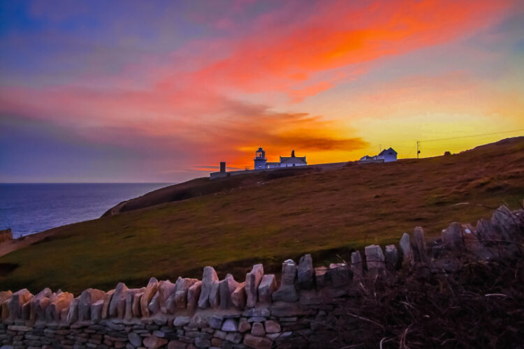 Durlston lighthouse during a sunset