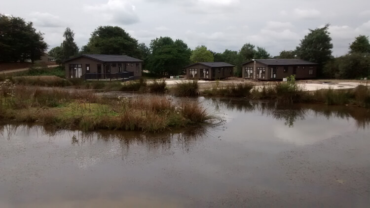 Photo of the duck pond and lodges at Keswick Reach