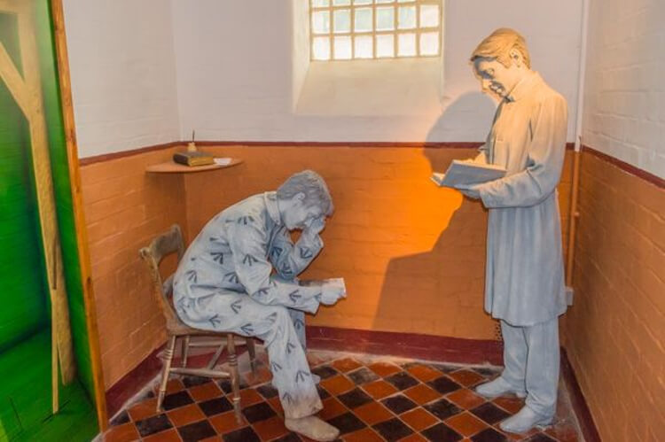 Model display of a doctor seeing an inmate