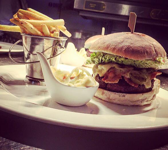 Burger and chips available at signatures restaurant