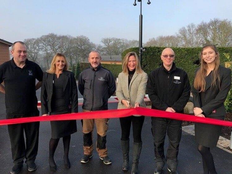 Staff at Wareham Forest cutting the red ribbon on opening day
