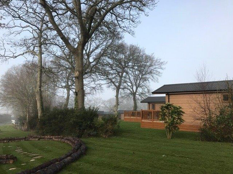 Side view of the lodges at Wareham Forest Lodge Retreat
