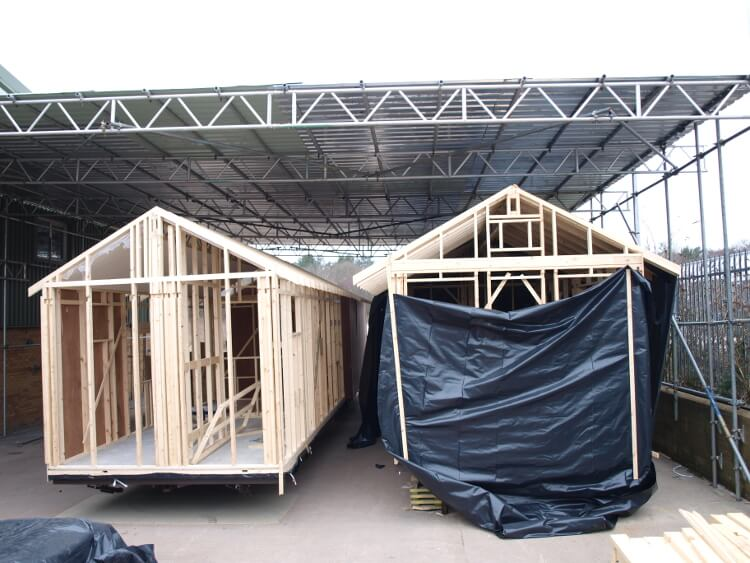 Photo of two beach huts under construction