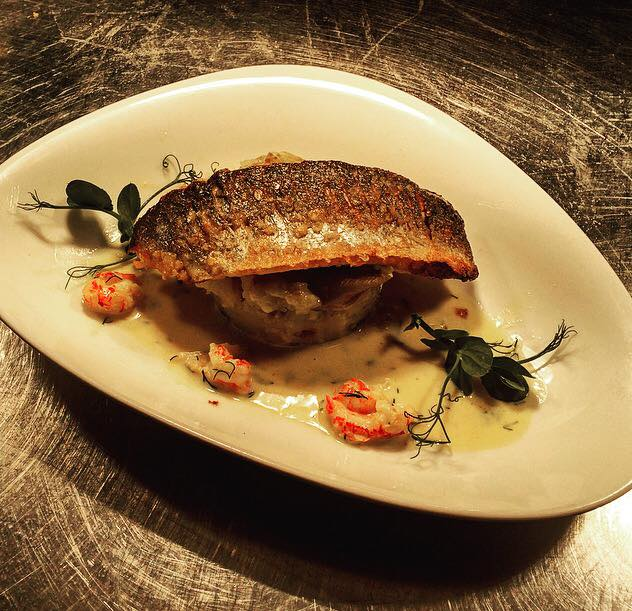 Photo of the seared sea bass with crushed new potatoes and a crayfish white wine cream
