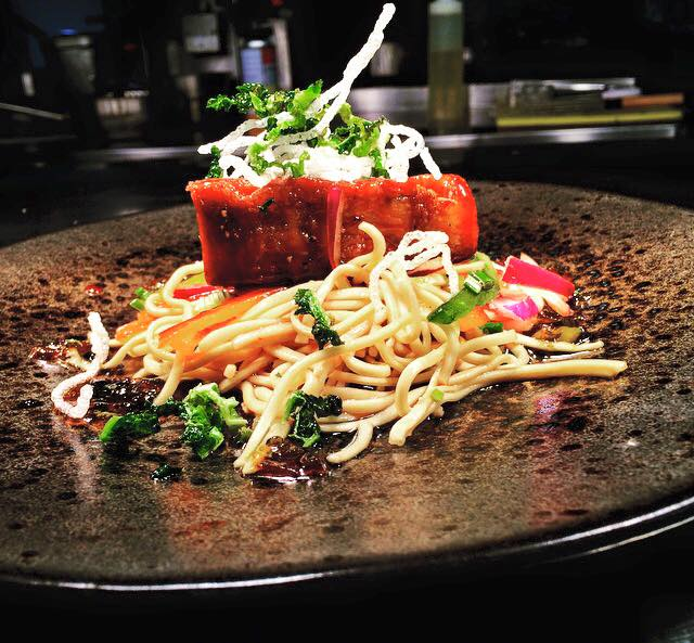 Photo of the sticky glazed belly pork with oriental noodle salad dressed in sweet chilli