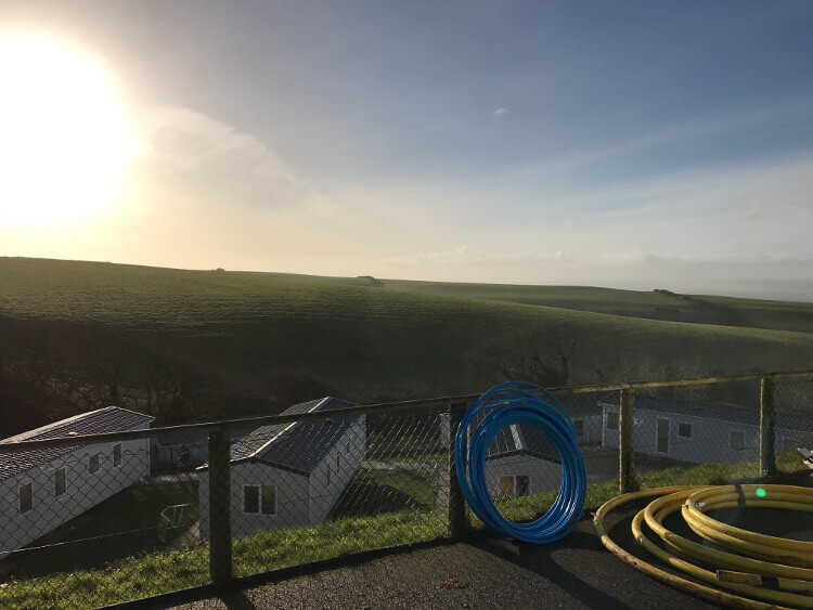 Photo of caravans at Sandymouth and their views