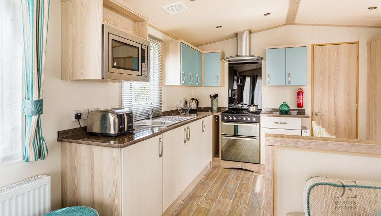 Interior shot of the kitchen in the ABI Beachcomber static caravan