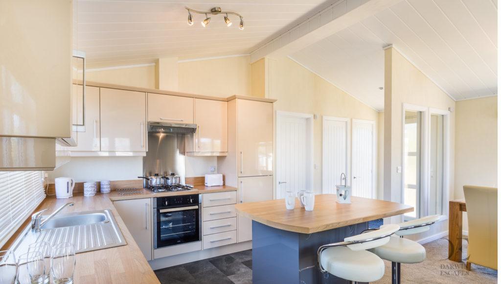 Interior shot of the kitchen in the Prestige Buckland Lodge