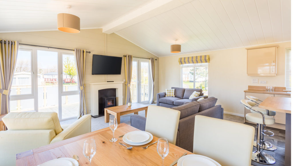 Interior shot of the dining area and lounge in the Prestige Buckland Lodge