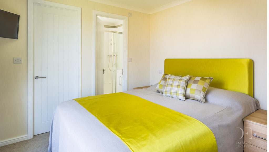 Interior shot of the master bedroom in the Prestige Buckland Lodge