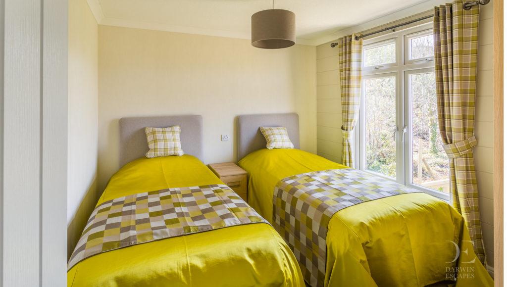 Interior shot of the twin bedroom in the Prestige Buckland Lodge