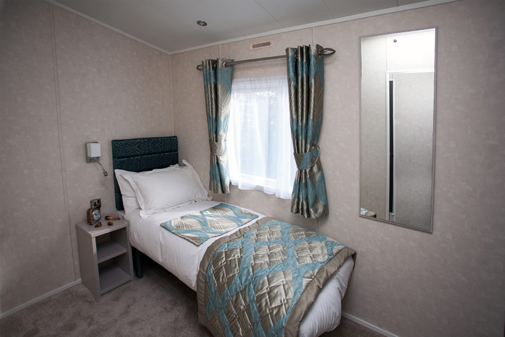 Interior shot of the twin bedroom in the Carnaby Envoy