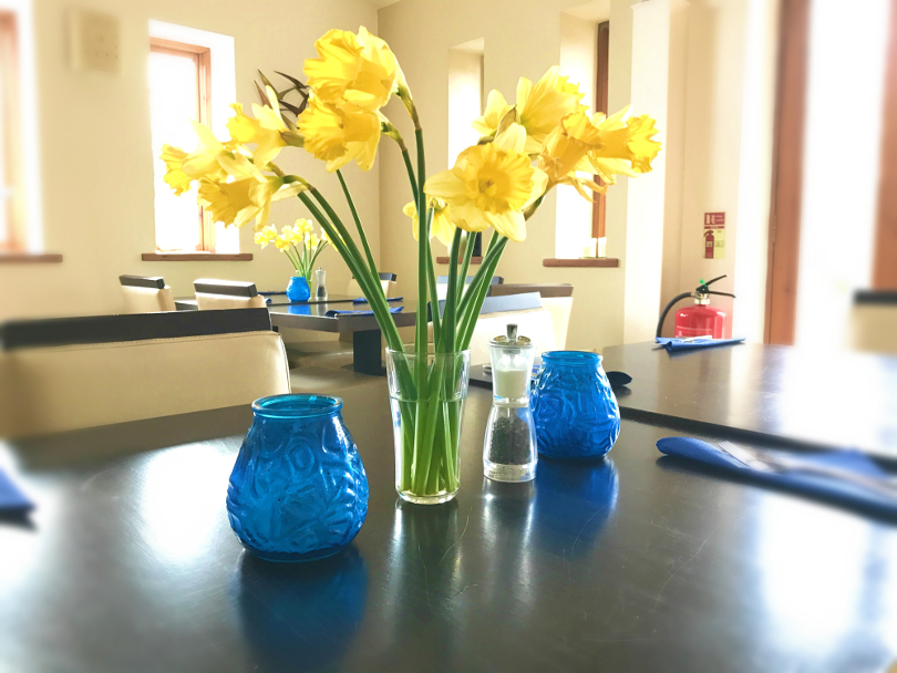 Daffodils in a vase on a table in the clubhouse