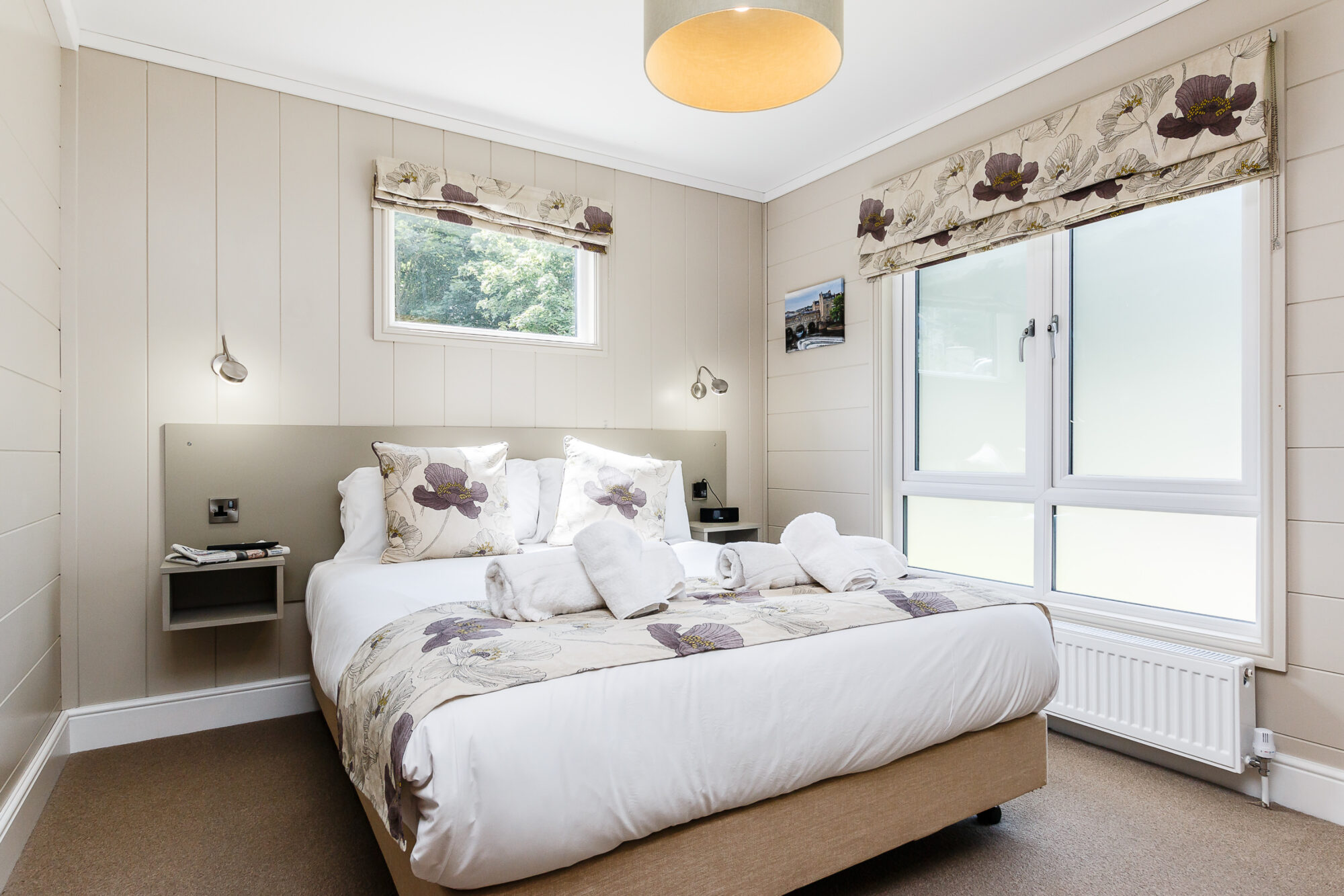 Interior shot of a bedroom in a lodge at Bath Mill