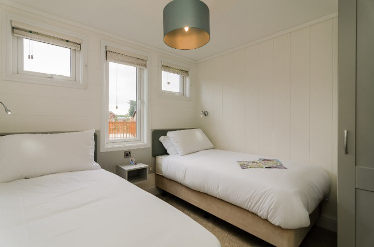 Interior of a twin bedroom in a lodge at Canterbury Reach