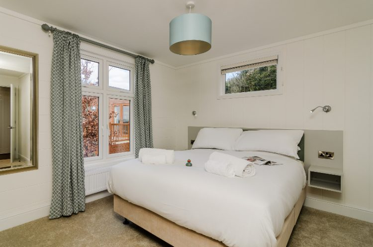 Interior of a double bedroom in a lodge at Canterbury Reach