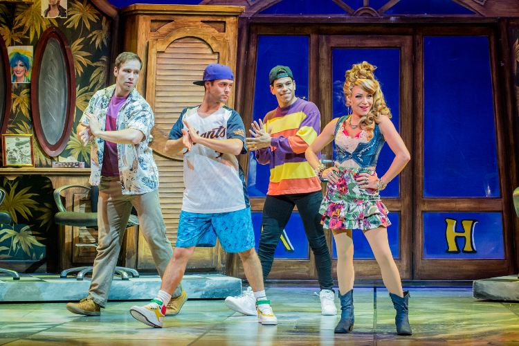 Legally Blonde cast performing a dance on stage