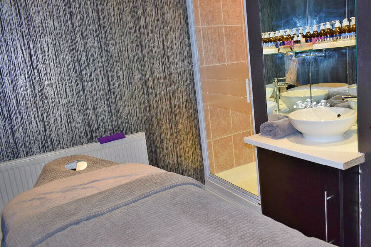 Interior shot of a massage table at Aberconwy Spa