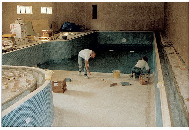 Builders tiling the pool at Aberconwy