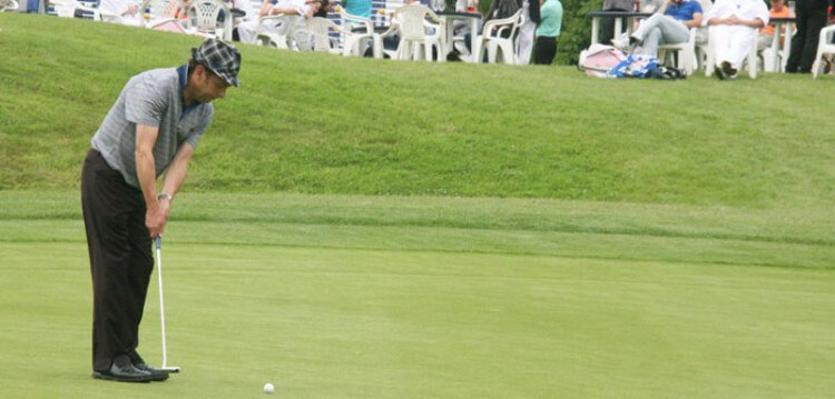 man playing golf at trilby tour