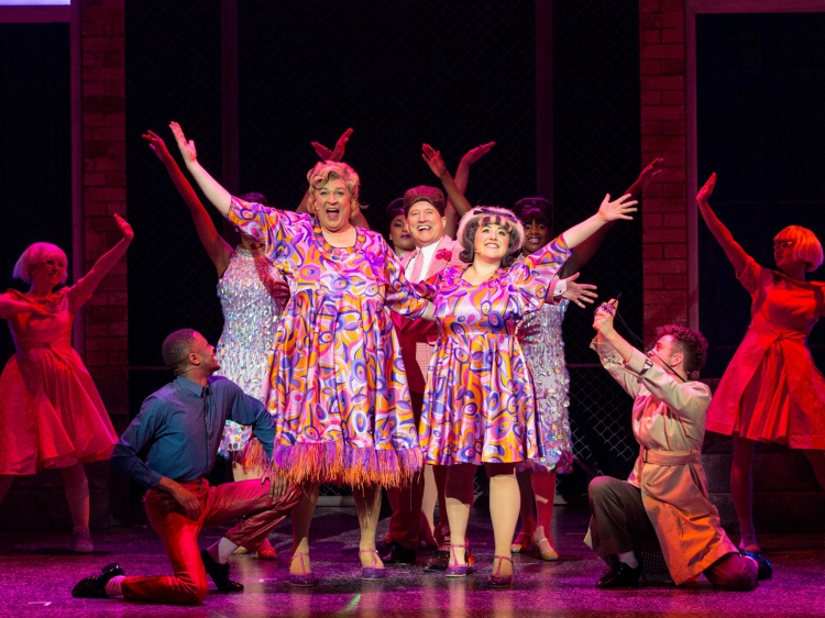 Photo of the Hairspray the Musical cast posing on stage