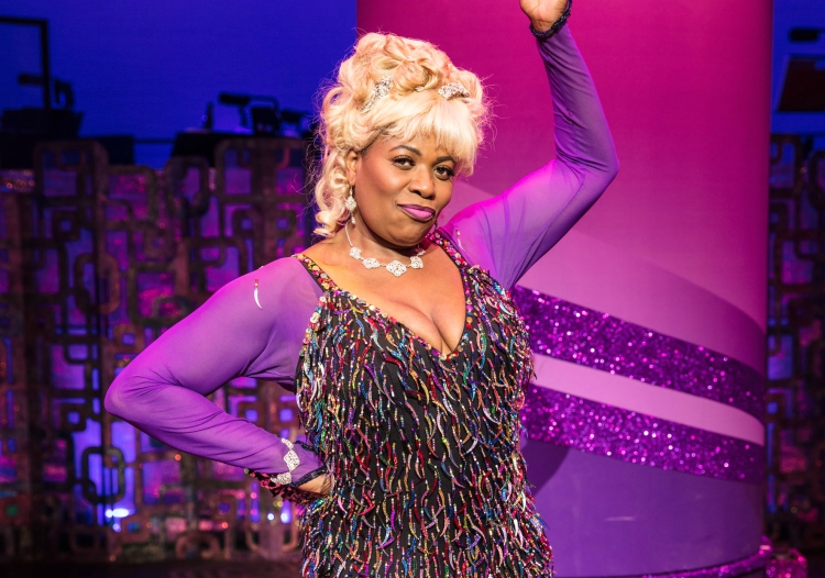 Cast member from Hairspray the Musical posing for a photo on stage