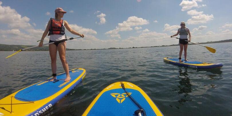 Two women paddleboarding