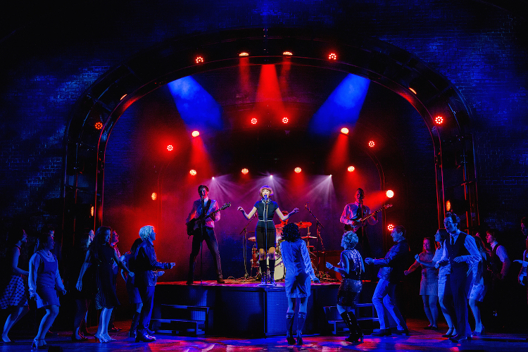 The cast of Cilla the Musical on stage during a performance