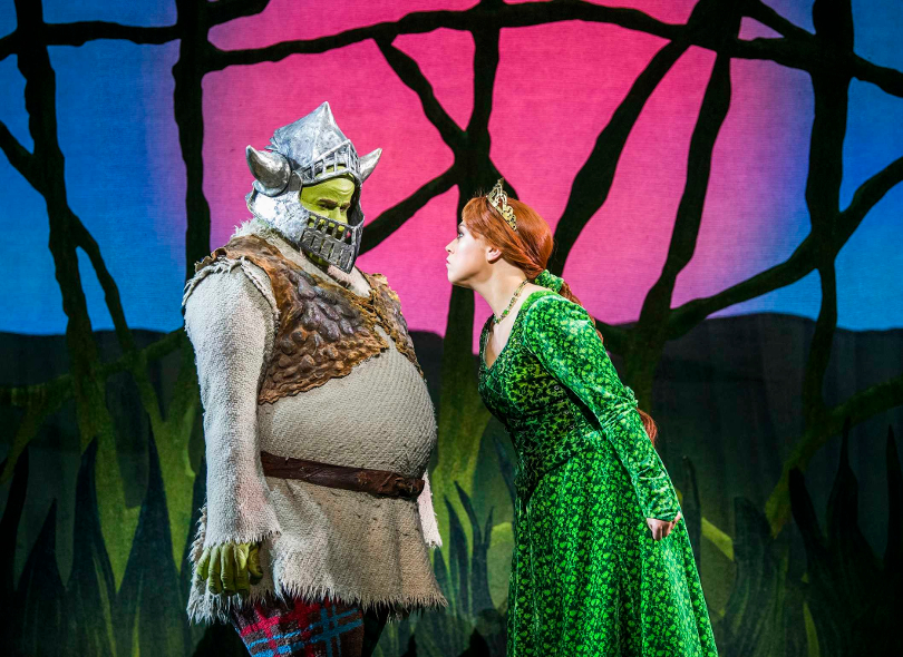 Photo of Princess Fiona and Shrek during a performance of Shrek the Musical