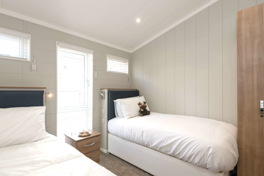 Interior shot of a Norfolk Woods lodge bedroom
