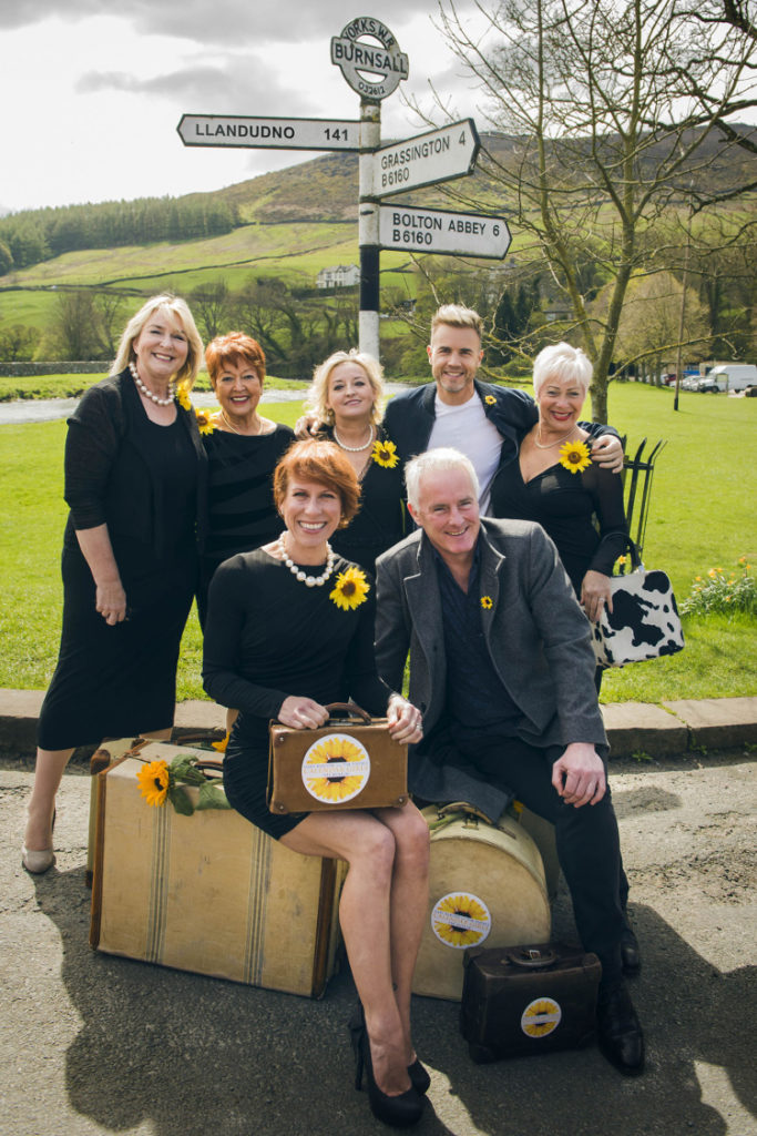 The cast of Calendar girls and the producers posing for a photo