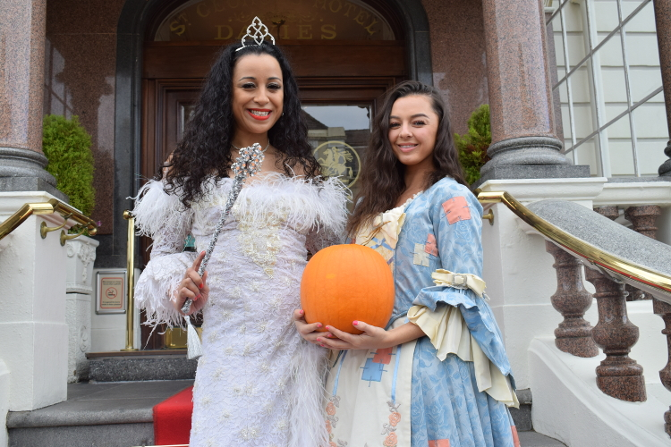 Cinderella and the Fairy Godmother posing for a photo