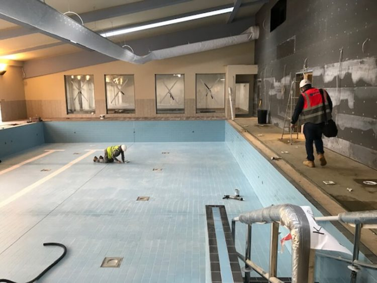 Construction workers working on the swimming pool