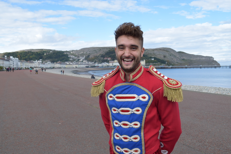 Tom Parker as Prince Charming posing for a photo