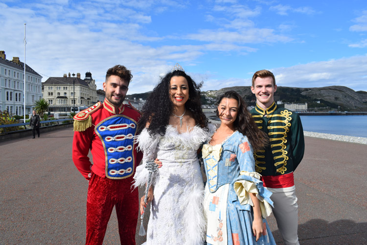 The Cinderella cast posing for a photo on the promenade