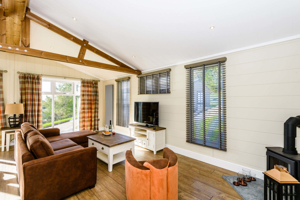 wood effect flooring in lounge with exposed wooden beams