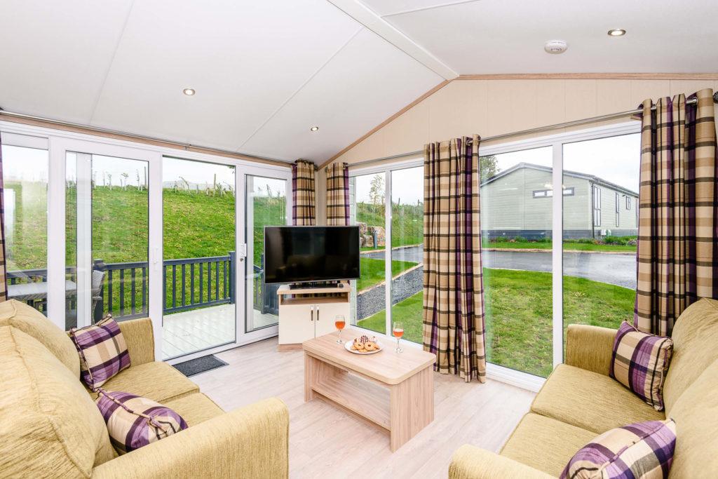 large corner windows in lounge of lodge