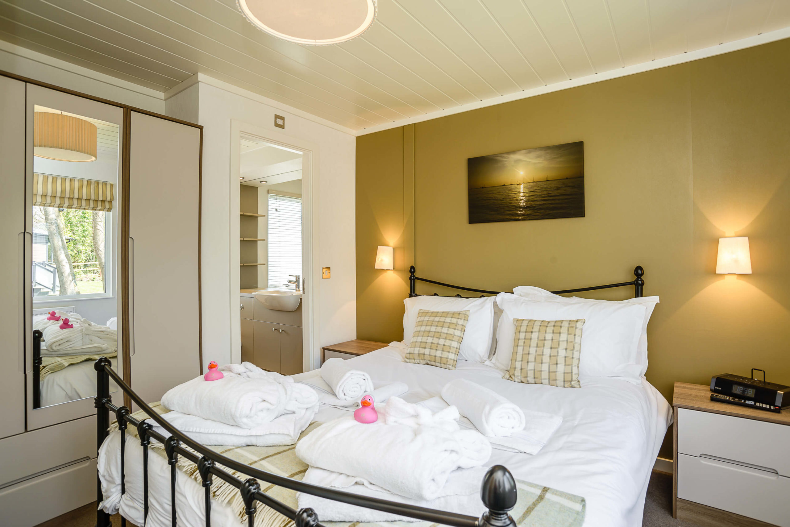 Interior shot of a bedroom in a Woodside Coastal lodge