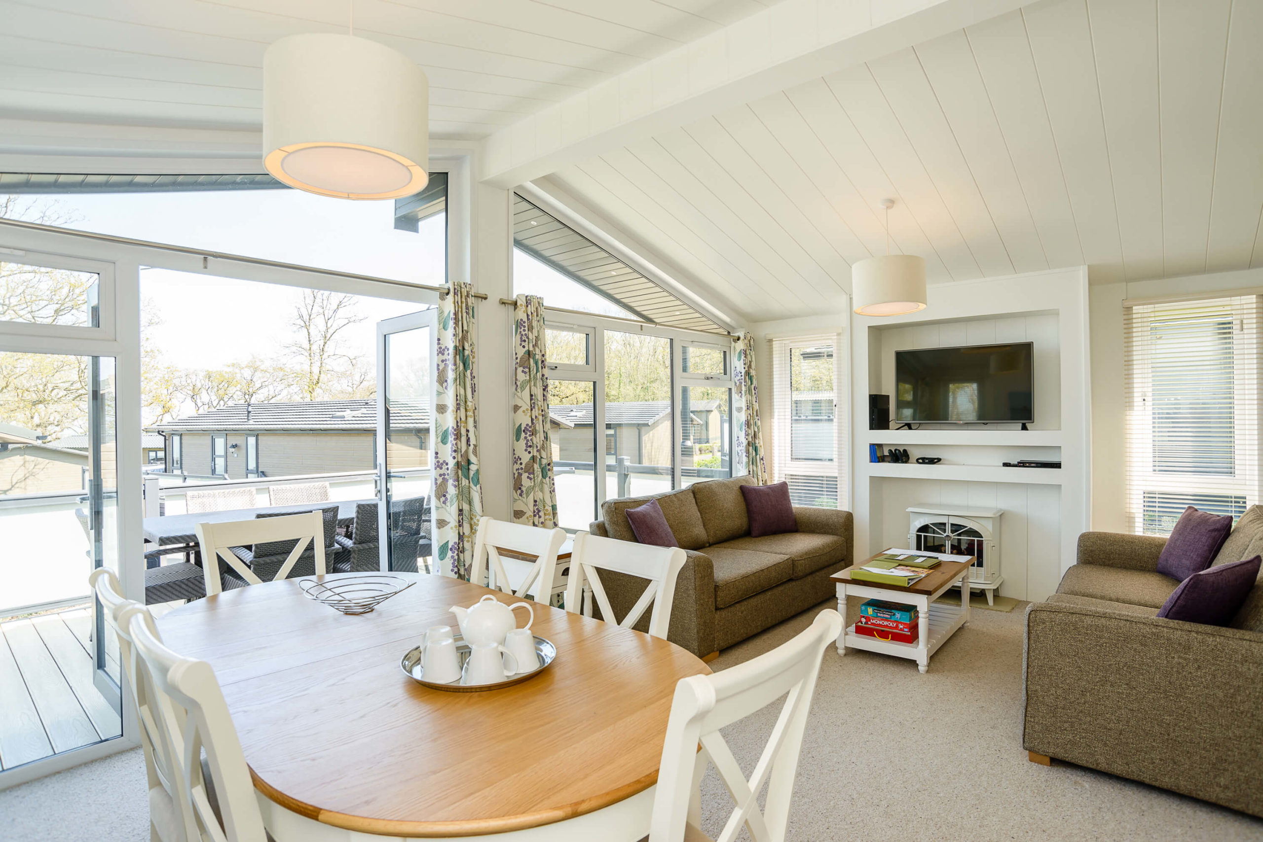 Interior shot of an open plan living area in a lodge at Woodside Coastal