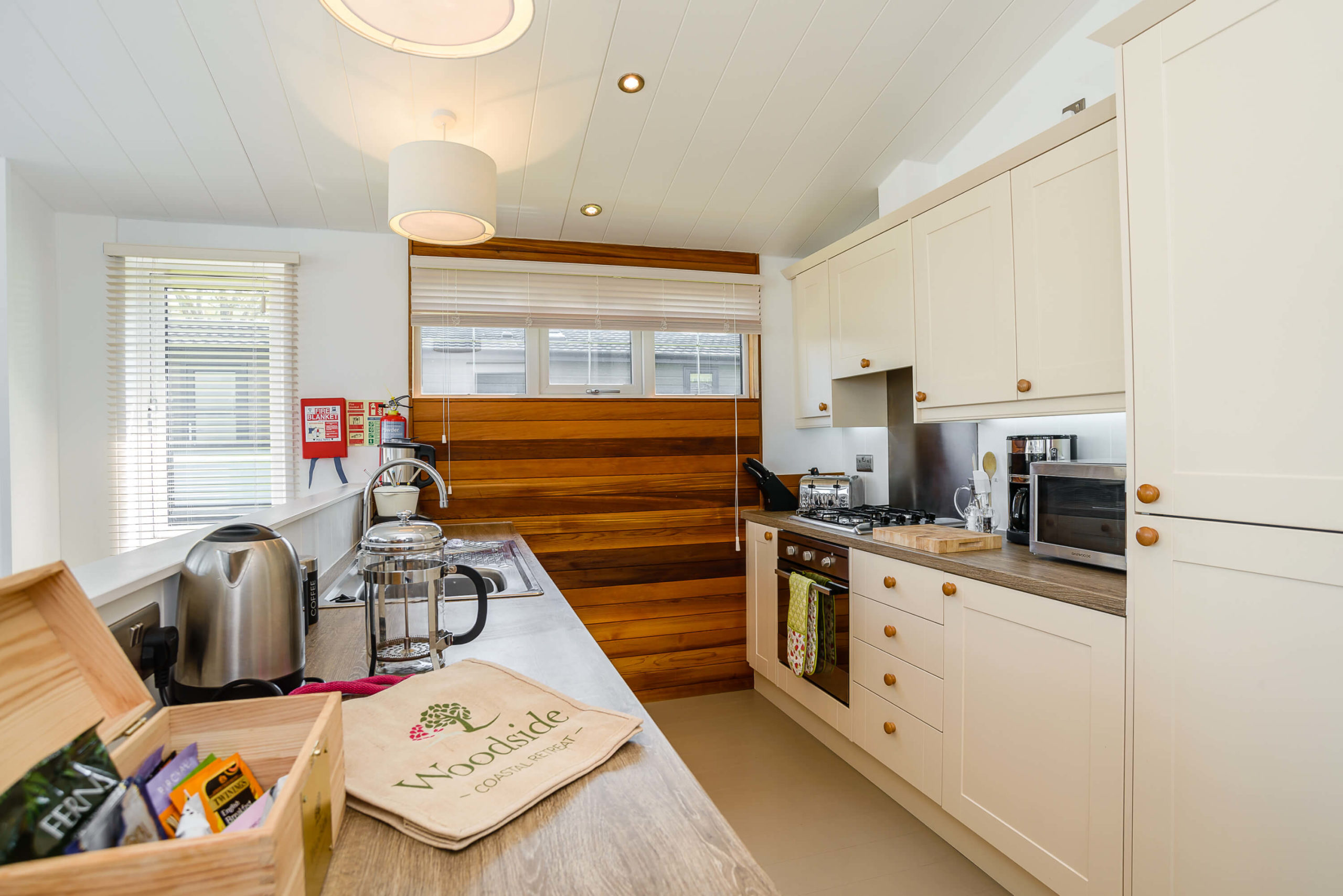 Interior shot of a kitchen in a lodge at Woodside Coastal
