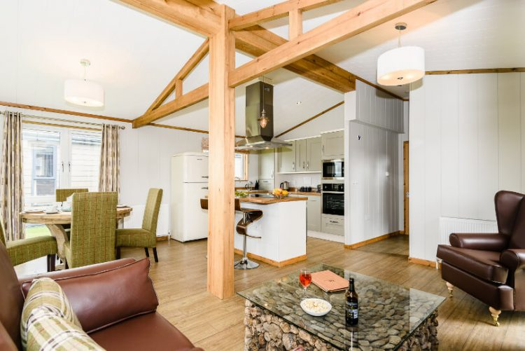 wooden beans in lounge with kitchen area