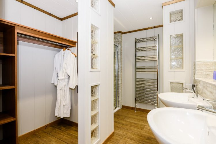 bathroom with tower rail and dressing gown hanging