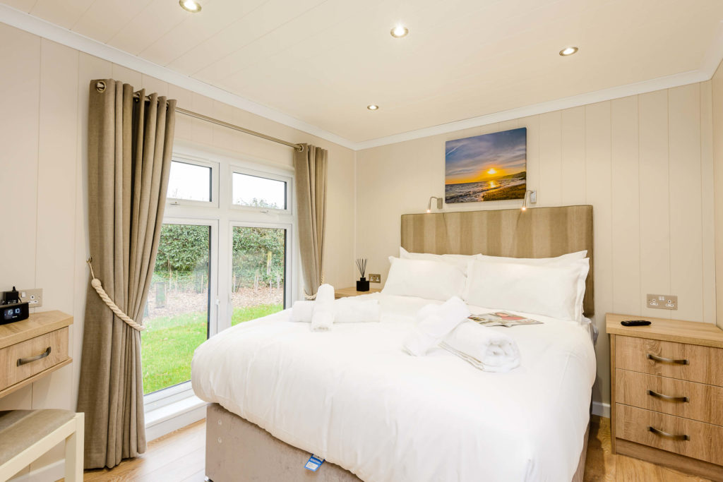 Master bedroom in a lodge at Wareham Forest