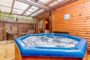 Photo of a hot tub in a lodge at Tilford Woods