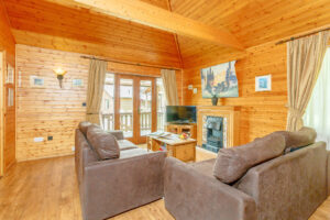 Interior shot of a lounge in a lodge at Tilford Woods